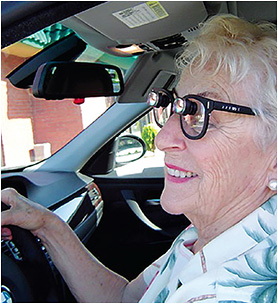 A low vision patient drives with her device assistance.